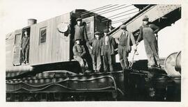 A Group of Men on A CN Crane Car in Biggar, Saskatchewan