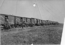 CNR Railway cars, with men unloading railroad ties