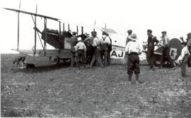 Crowd looking at a Bi-plane