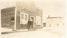 A man in front of the Pool Hall and Cafe - Beatty, Sask.